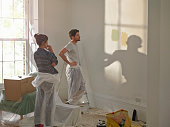A man and woman doing DIY in new home