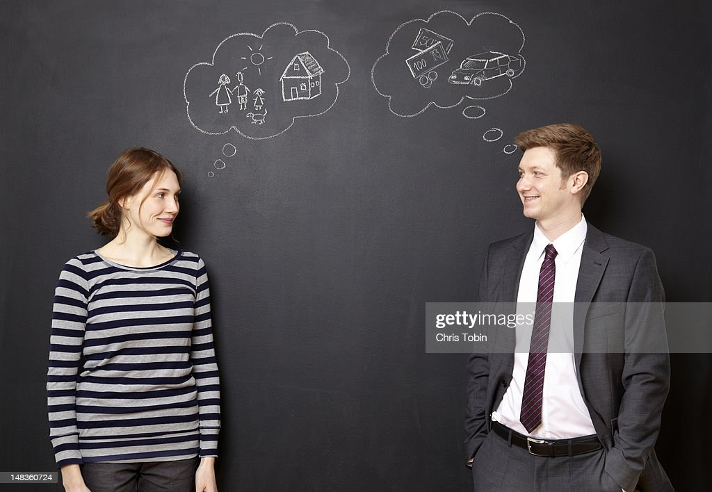 Man and woman dreaming about their future : Stock Photo