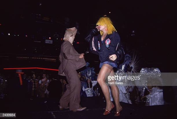 A man and woman dressed in costume dance during the 'Magic Fantasy and Dreams' Halloween Eve party at the nightclub Studio 54 New York City October...