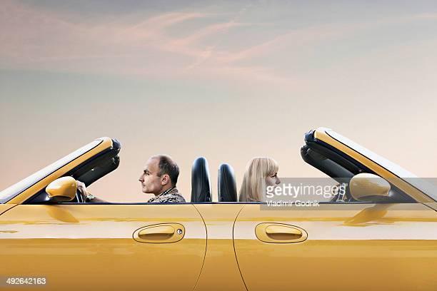 Man and woman driving car