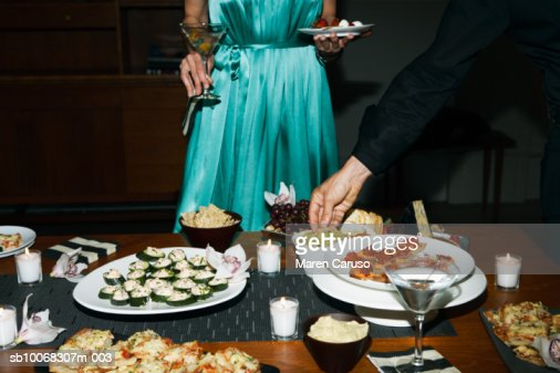 Man and woman eating appetizers at cocktail party : Stock Photo