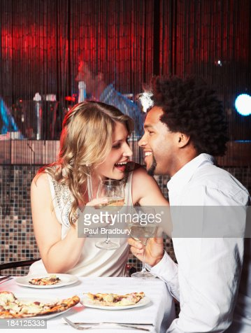 Man and woman eating dinner at restaurant : Stock Photo