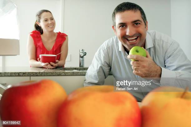 Man and woman eating healthy food
