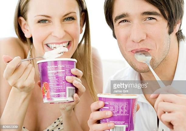 Man and Woman eating ice cream out of the cartons