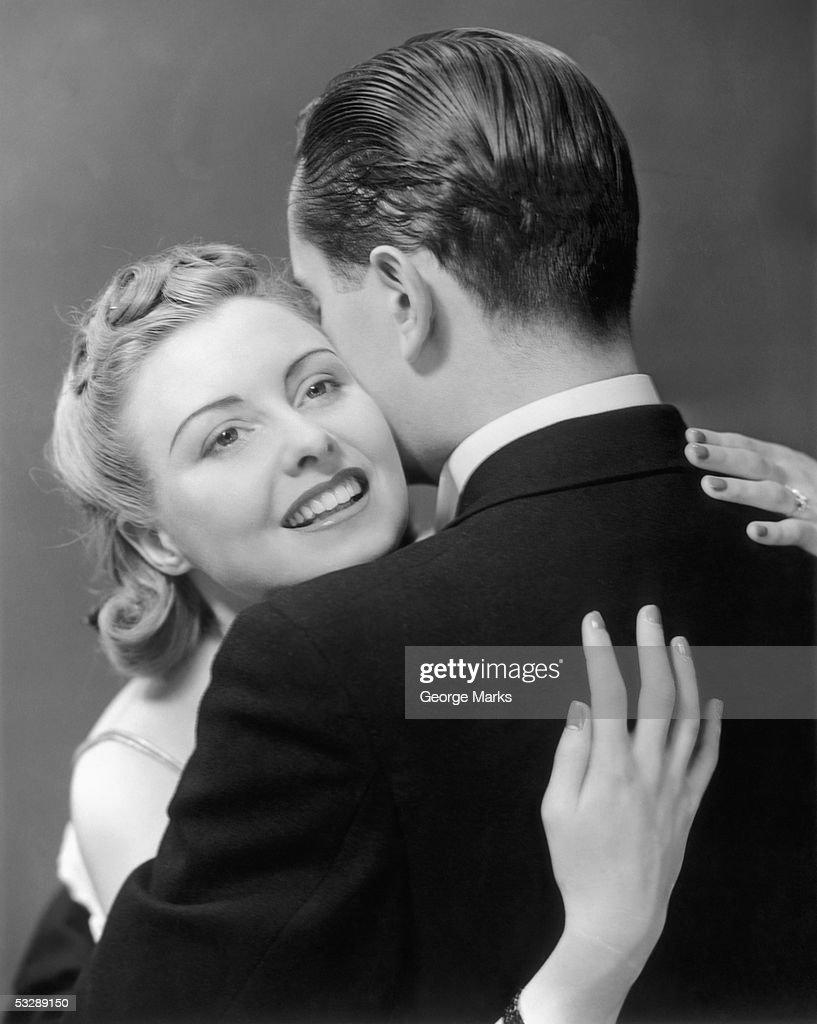 Man and woman embracing : Stock Photo