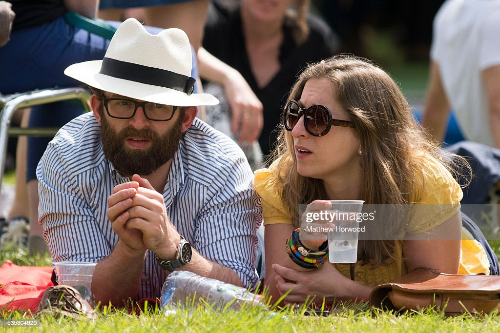 A man and woman enjoying the warm summer weather during the 2016 Hay Festival on May 29, 2016 in Hay-on-Wye, Wales. The Hay Festival is an annual festival of literature and arts now in its 29th year.