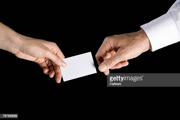 A man and woman exchanging a business card