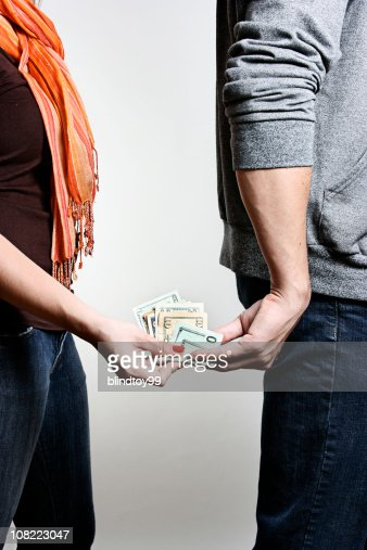 Man and Woman Exchaning Wad of Money : Stock Photo