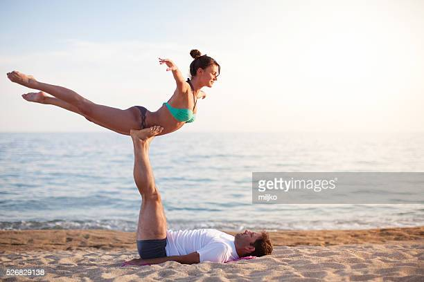 Man and woman exercising on the beach