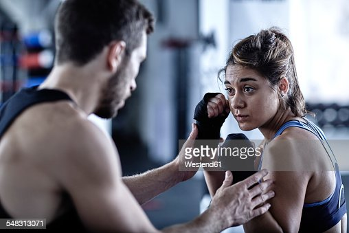 Man and woman exercising with punchingballs