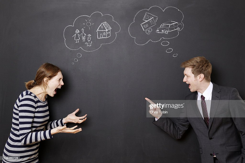 Man and woman fighting about their future : Stock Photo