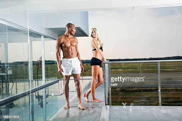 Man and woman flirting by pool