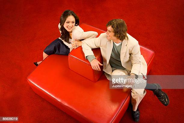 Man and woman flirting in lounge