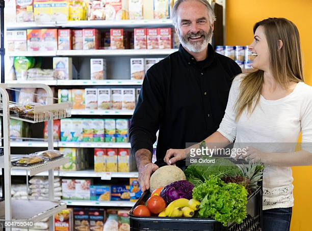 Man and Woman Grocery Shopping