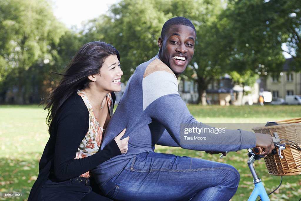 man and woman having fun on bicycle : Stock Photo