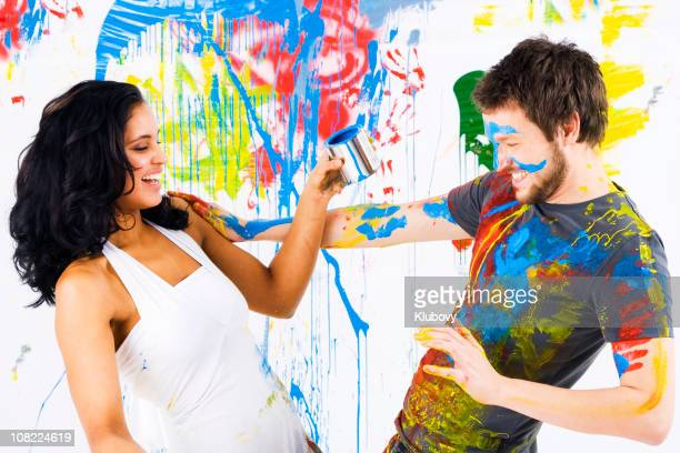 Man and Woman Having Fun with Paint