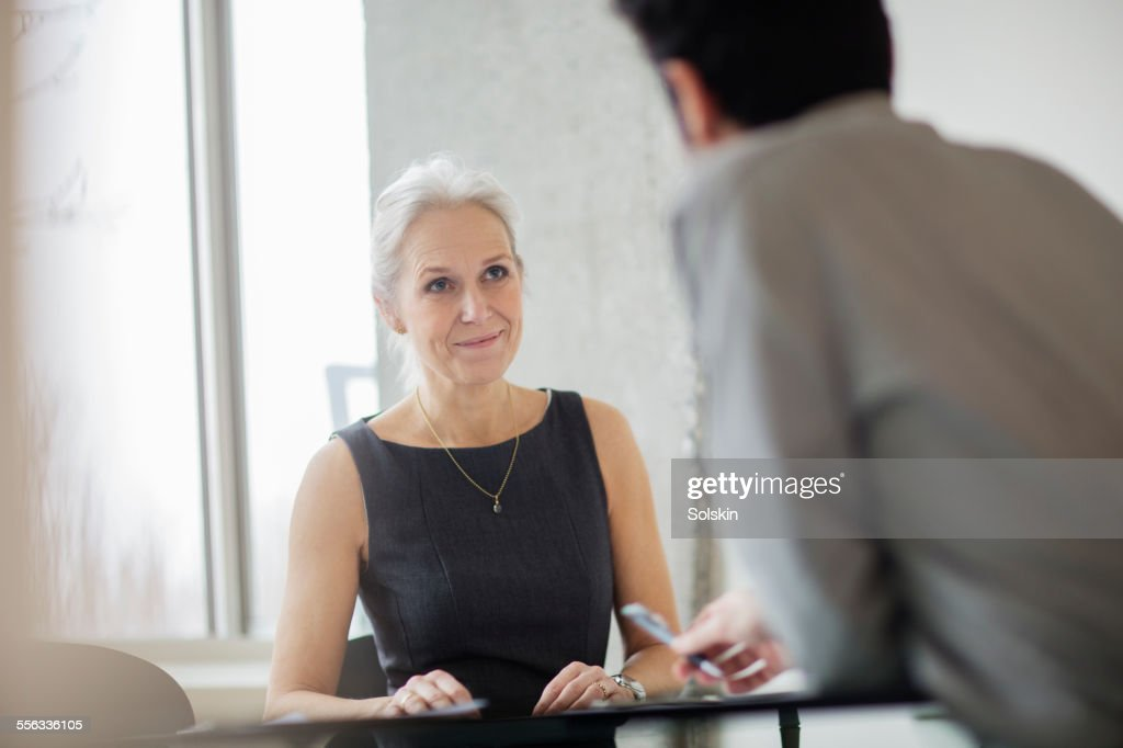 man and woman having office meeting