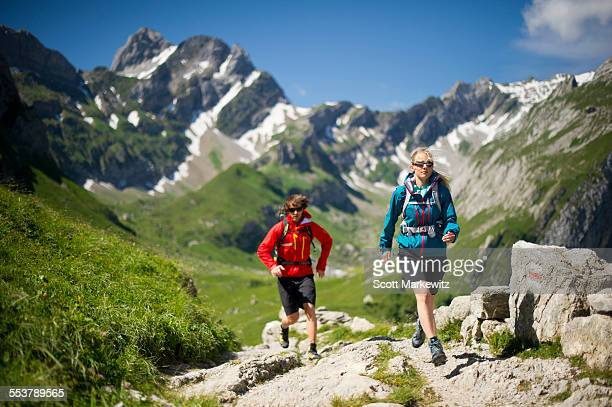 Man and woman hiking, Appenzellerland, Switzerland.