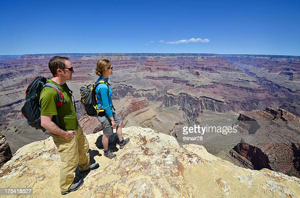 A man and woman hiking in the Grand Canyon