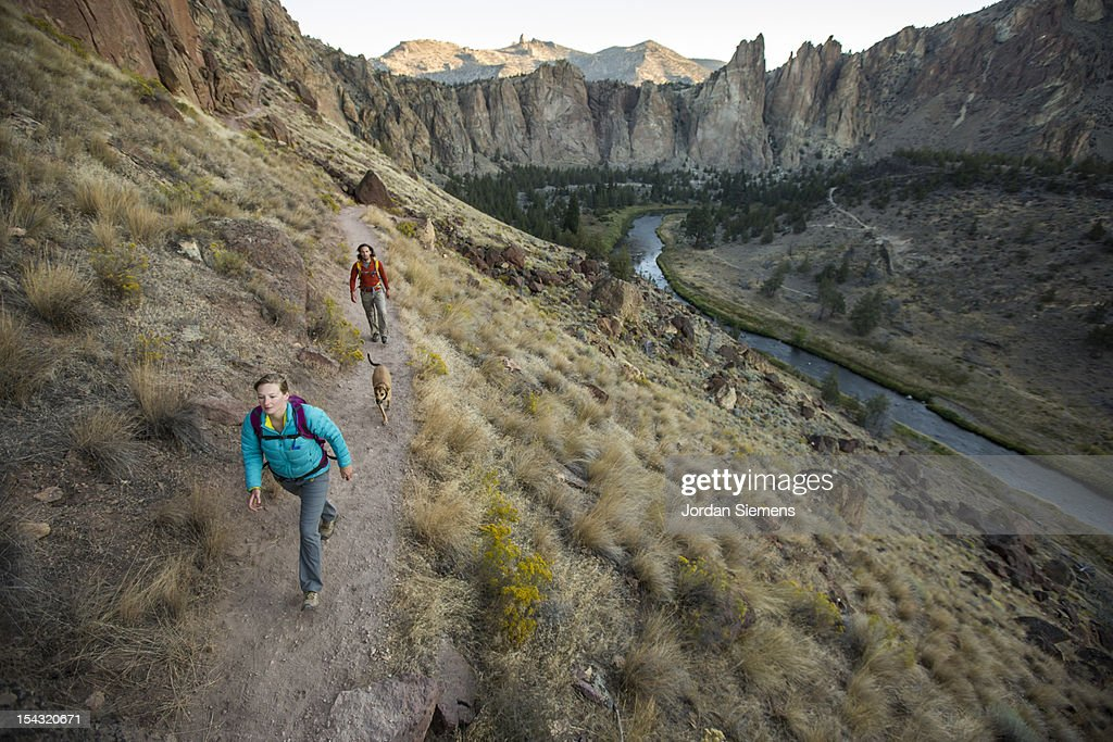 A man and woman hiking. : Stock Photo