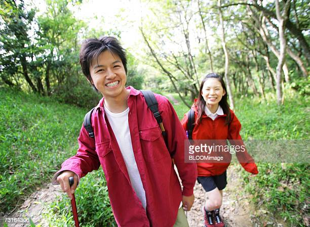 Man and woman hiking, wearing foul weather gear