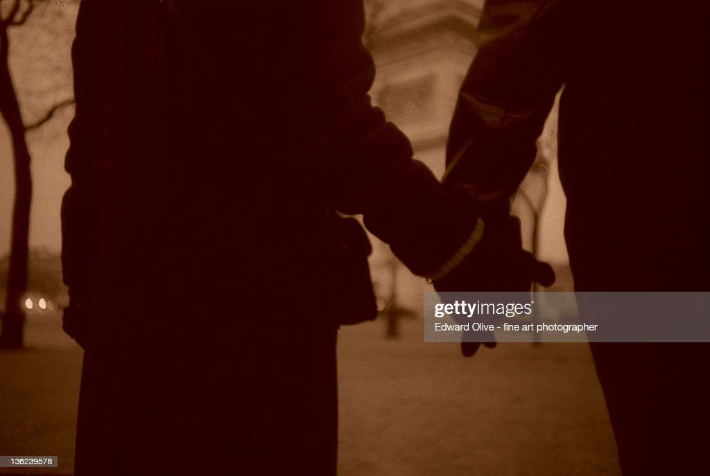 Man and woman holding hands : Stock Photo