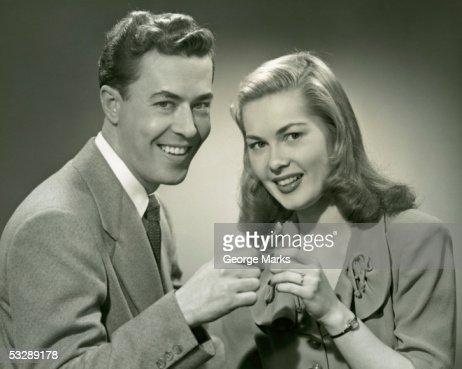 Man and woman holding wishbone : Stock Photo