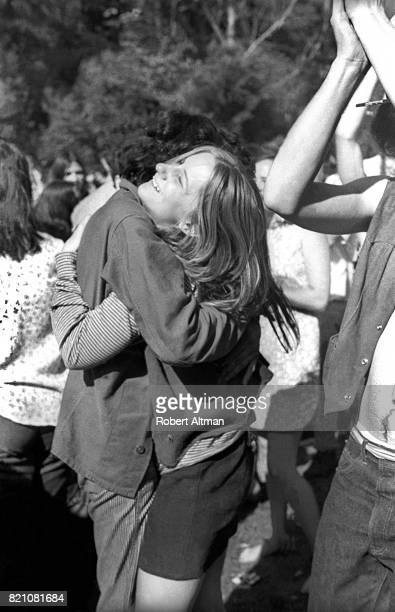 A man and woman hug during a Golden Gate Park BeIn event on March 21 1969 in San Francisco California