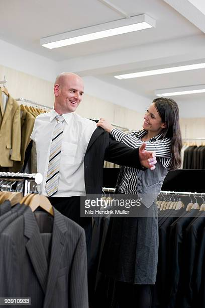 man and woman in clothing store