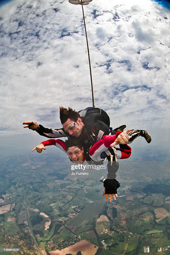 Man and woman in parachute : Stock Photo