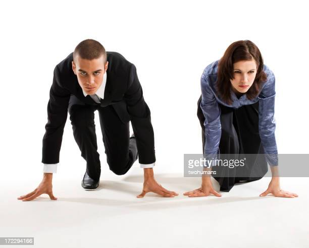 Man and woman in racers ready position on the ground