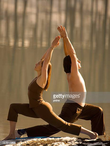 Man and Woman in same Yoga Pose