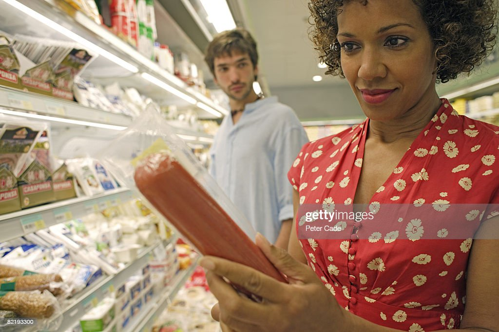 Man and woman in supermarket : Stock Photo