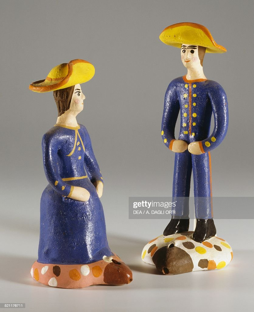 Man and woman in traditional dress whistles made in Estremoz Portugal 20th century Cesuna Museo Dei Cuchi Portugal