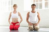 Man and woman kneeling, eyes closed