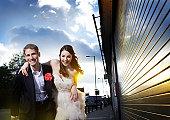 man and woman laughing running down street at dawn