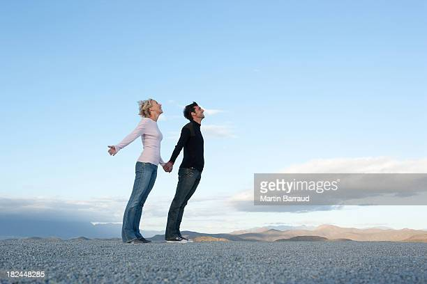 Man and woman leaning into the wind