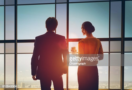 man and woman look at the city : Stock Photo