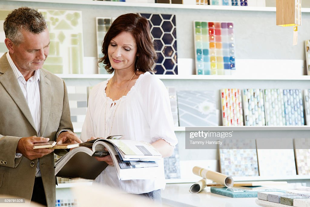 Man and woman looking at color swatches : Stock Photo