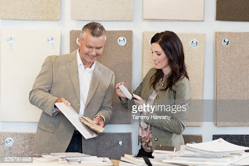 Man and woman looking at color swatches : Stock-Foto
