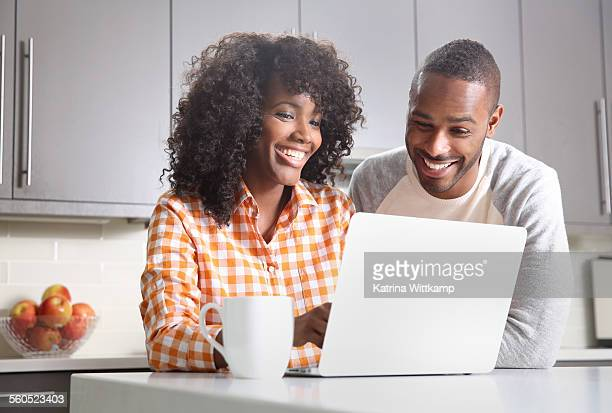 Man and woman looking at laptop computer.