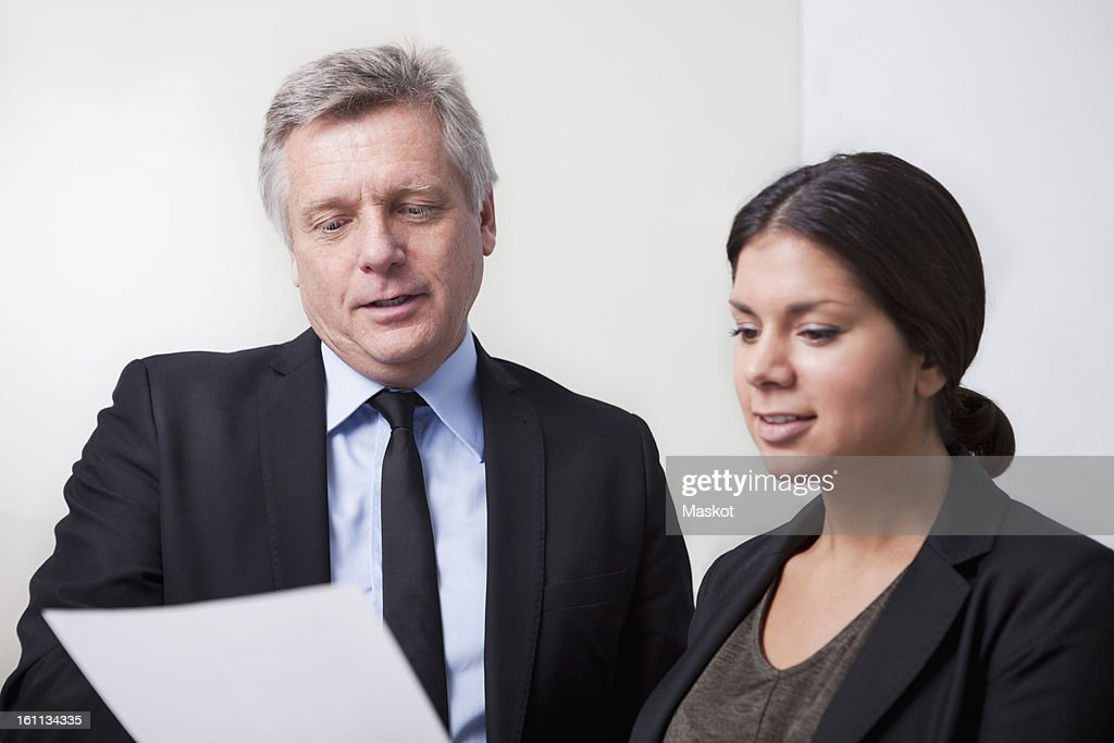 Man and woman looking at paper : Stock Photo