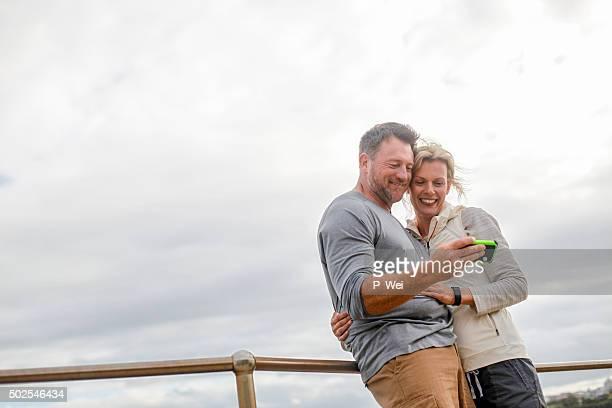 Man and woman looking at smartphone
