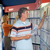 Man and woman looking for DVD's in rental shop