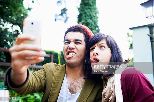 man and woman making funny faces for selfie