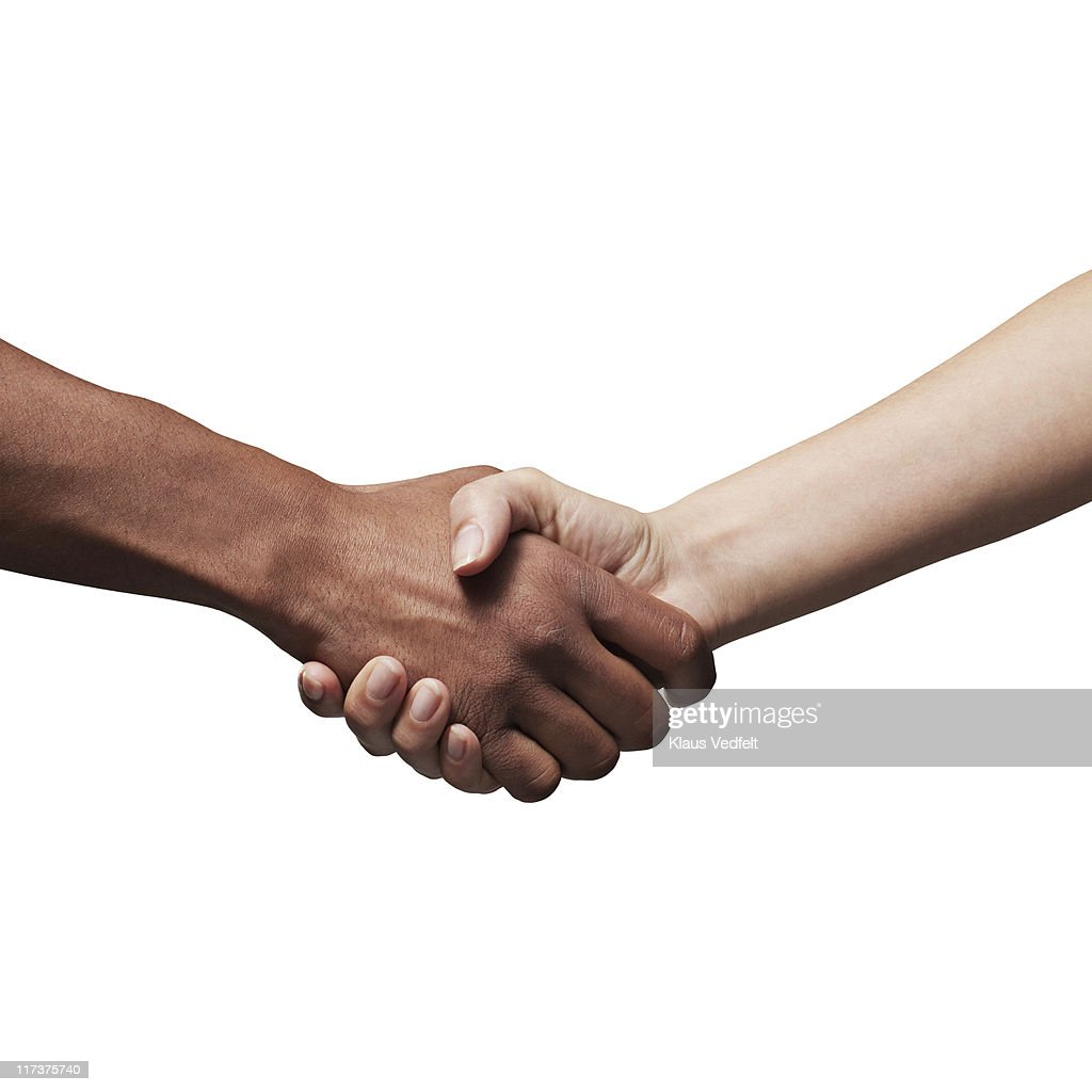 Man and woman making handshake : Stock Photo