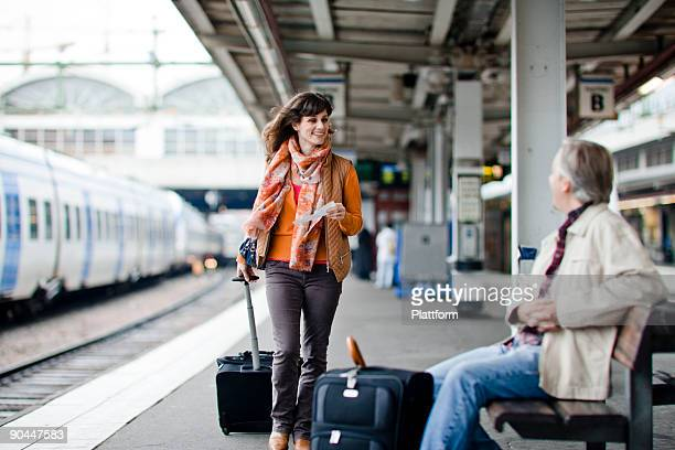 A man and woman on a platform at a railway station Sweden.