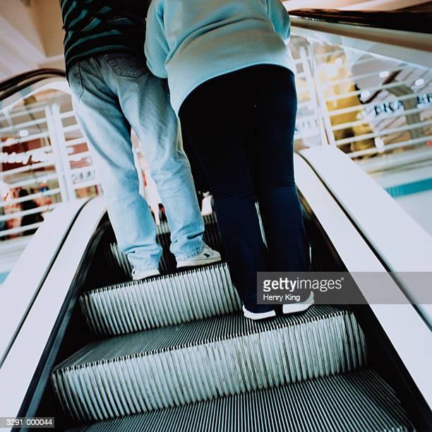 Man and Woman on Escalator