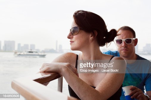 Man and woman on river boat to Asakusa in Tokyo