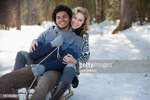 Man and woman on sled : Stock Photo